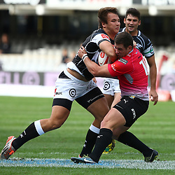 DURBAN, SOUTH AFRICA - SEPTEMBER 05:  Andre Esterhuizen of the Cell C Sharks tackled by Juan-Claude Roos of the Steval Pumas during the Absa Currie Cup match between Cell C Sharks and Steval Pumas at Growthpoint Kings Park on September 05, 2015 in Durban, South Africa. (Photo by Steve Haag/Gallo Images)