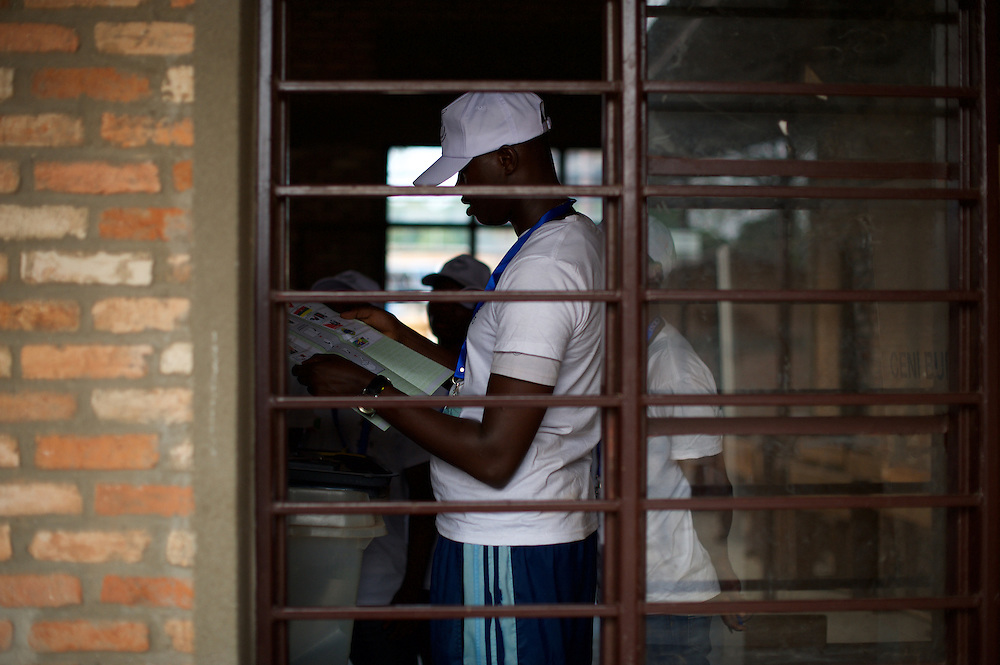 Members of the Burundian National Independent Electoral Commission count votes for the parliamentary elections at a polling station near Musaga neighbourhood, Bujumbura, June 29, 2015.