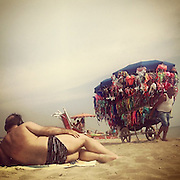 Capocotta beach , Rome 2015 : man and swimsuit vendor.