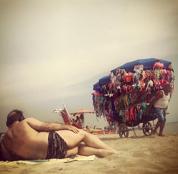 Capocotta beach , Rome 2015 : man and swimsuit vendor.