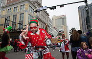 Elvis impersonators in the sixth annual Krewe of Jingle New Orleans Christmas Parade. New Orleans has becom e one of the top tourist holiday destinations in the America.