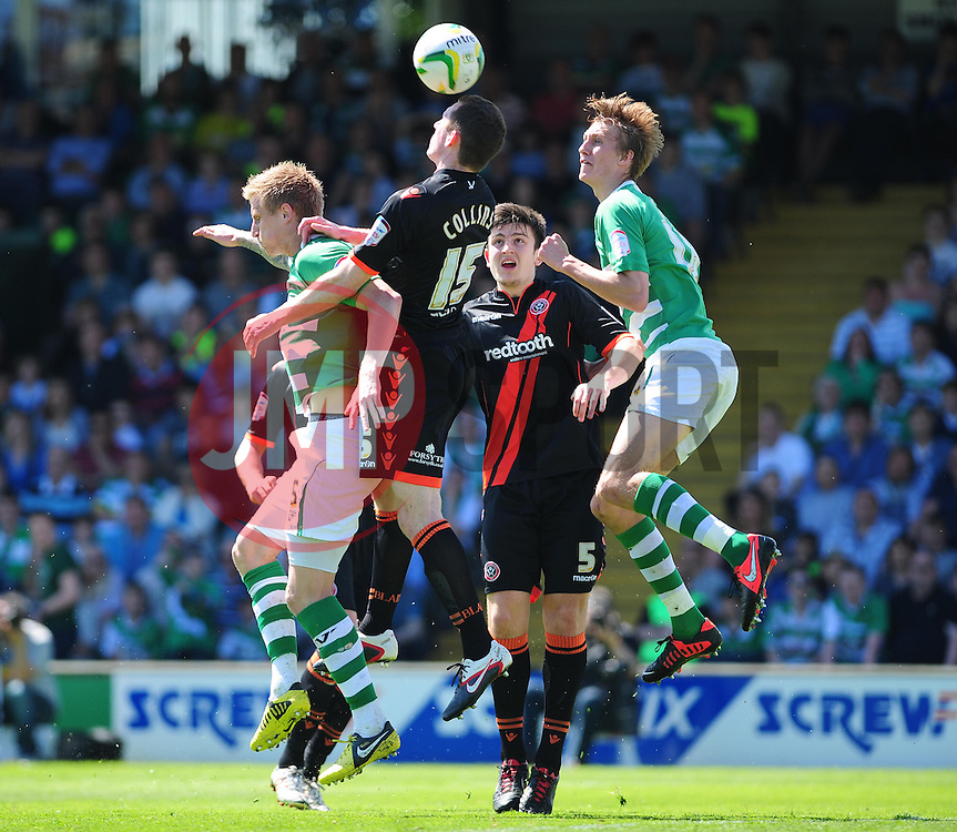 Sheffield United's Neil Collins clears the ball from danger - Photo mandatory by-line: Dougie Allward/JMP - Tel: Mobile: 07966 386802 06/05/2013 - SPORT - FOOTBALL - Huish Park - Yeovil - Yeovil Town V Sheffield United - NPOWER LEAGUE ONE PLAY-OFF SEMI-FINAL SECOND LEG