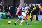 Chris Lowe of Huddersfield Town (15) takes on Pablo Zabaleta of West Ham United (5), Chris Lowe of Huddersfield Town (15) would find himself injured shortly after this, during the Premier League match between Huddersfield Town and West Ham United at the John Smiths Stadium, Huddersfield, England on 10 November 2018.