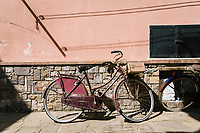 ACCIAROLI, ITALY - 14 SEPTEMBER 2018: A bicycle is parked here in a street of Acciaroli, a small fishing village in the municipality of Pollica, Italy, on September 14th 2018.<br /> <br /> To understand how people can live longer throughout the world, researchers at University of California, San Diego School of Medicine have teamed up with colleagues at University of Rome La Sapienza to study a group of 300 citizens, all over 100 years old, living in Acciaroli (Pollica), a remote Italian village nestled between the ocean and mountains in Cilento, southern Italy.<br /> <br /> About 1-in-60 of the area's inhabitants are older than 90, according to the researchers. Such a concentration rivals that of other so-called blue zones, like Sardinia and Okinawa, which have unusually large percentages of very old people. In the 2010 census, about 1-in-163 Americans were 90 or older.