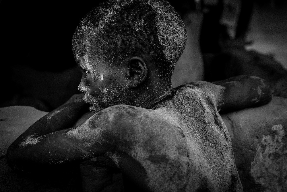 Bijagos Islands in Guinea Bissau, children play in the sand.
