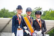 Podium Young Riders 1. Thalia Rockx - Verdi de la Fazenda, 2. Daphne van Peperstraten - Greenpoint's Cupido, 3. Febe van Zwambagt - Fyeo<br /> NK Dressuur 2019<br /> © DigiShots