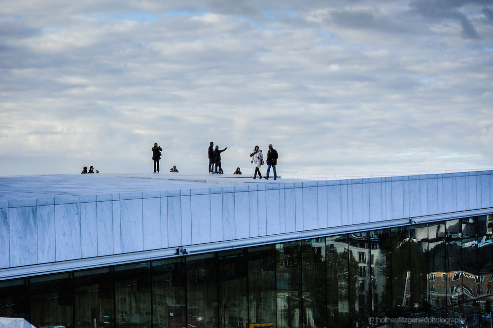 Oslo, Norway, October 2012: People walking on top of the opera house.EDITORIAL ONLY: This Image is only for Editorial Use