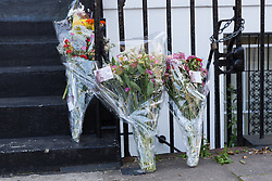 © Licensed to London News Pictures. 25/08/2017. LONDON, UK.  Floral tributes outside a house in Mitchison Road, off Essex Road in Islington. A 27 year old man was stabbed on Thursday evening and later died in hospital. Photo credit: Vickie Flores/LNP