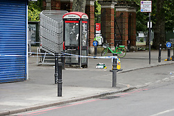 © Licensed to London News Pictures. 09/07/2019. London, UK. A medical kit is seen at the entrance of Finsbury Park<br /> on Seven Sisters Road, north London following a stabbing at about 9.45pm on Monday 8 July 2019. Police officers found a 30 years old man suffering a knife wound and a second man, believed to be in his late twenties, was discovered with a gunshot injury in the nearby Blackstock Road. According to the police, the stab victim is in a stable condition. Photo credit: Dinendra Haria/LNP