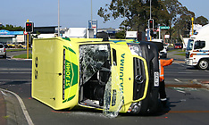 Auckland-Ambulance overturns after collision, Manukau