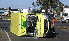 Auckland-Ambulance overturns after collision, Manukau