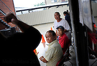 NEW ORLEANS, LA- June 22: Vietnamese affected by the Gulf oil spill because of their work in the fishing industry, wait on an early morning line at Mary Queen of Vietnam Catholic Church to receive financial assistance from Catholic Community Services, in New Orleans, Louisiana, Tuesday June 22, 2010.  (Melina Mara/The Washington Post)