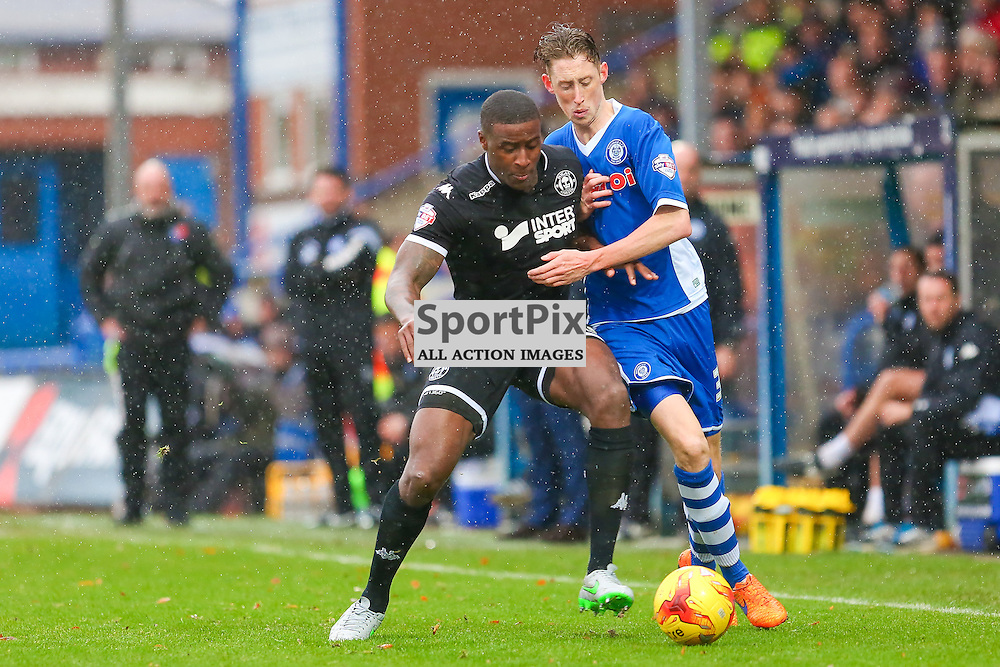Donavon Daniels in action with Joe Bunney during Rochdale v Wigan Athletic , Sky Bet League One Match, 14 November 2015<br /> Picture by Jackie Meredith/SportPix.org.uk