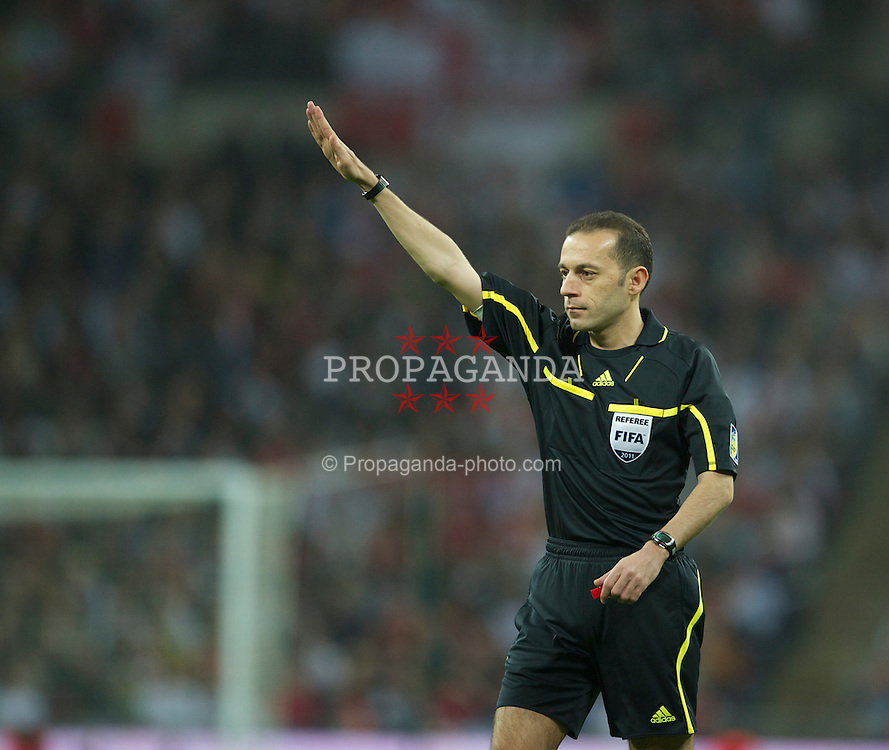 LONDON, ENGLAND - Tuesday, March 29, 2011: Turkish referee Cuneyt Cakir during the international friendly match between England and Ghana at Wembley Stadium. (Photo by David Rawcliffe/Propaganda)