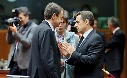 Nicolas Sarkozy, France's president, right, speaks with Jose Zapatero, Spain's prime minister, left, during an emergency EU Summit to solve Europe's debt crisis at the European Council headquarters in Brussels, Belgium, on Wednesday, Oct. 26, 2011. (Photo © Jock Fistick)