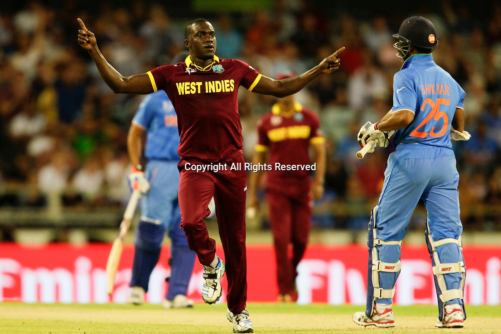 06.03.2015. Perth, Australia. ICC Cricket World Cup. India versus West Indies. Jerome Taylor celebrates the wicket of Shikhar Dhawan.