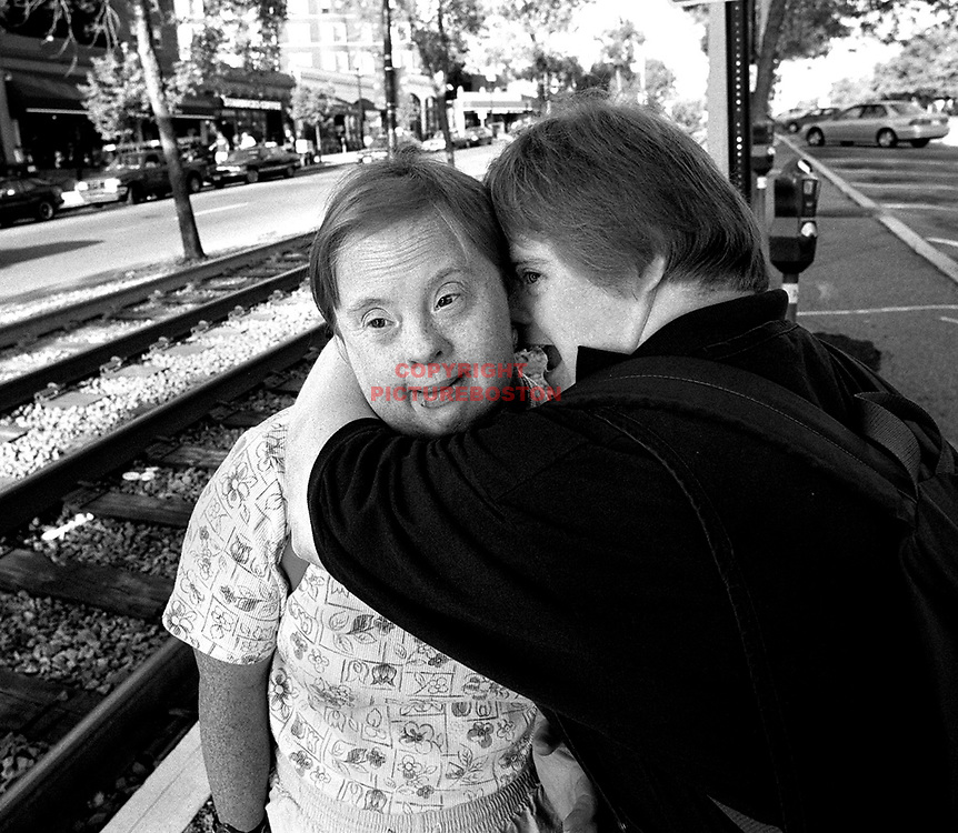 "fragm  ""Best Friends"" -Best friends and longtime fellow owners of a Washington Square home, LtoR Ann  Chittim and Sandy Tuttle, embrace while waiting for the 7AM trolley to take them to work."