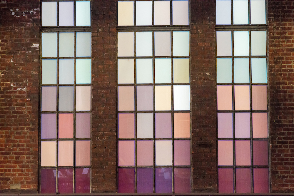 Close-up of industrial colored windows in a brick building in New York City, New York, USA