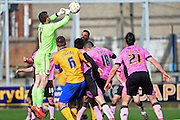 Northampton Town goalkeeper Adam Smith clears a corner with a punch during the Sky Bet League 2 match between Mansfield Town and Northampton Town at the One Call Stadium, Mansfield, England on 28 March 2016. Photo by Jon Hobley.