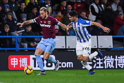 Marko Arnautovic of West Ham United (7) holds off Christopher Schindler of Huddersfield Town (26) during the Premier League match between Huddersfield Town and West Ham United at the John Smiths Stadium, Huddersfield, England on 10 November 2018.