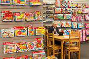 UNITED KINGDOM, London: 22 January 2019. A member of staff at one of the many stalls is hard at work at The Toy Fair 2019 being held at Olympia London this morning. The Toy Fair, which runs between 22nd-24th of January, is the UK's largest toy trade event with over 250 exhibiting companies launching thousands of new products. <br /> Rick Findler / Story Picture Agency