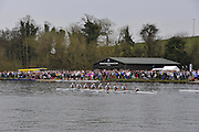Henley. United Kingdom. Oxford Women's Blue Boat passing Uppers Thames Rowing Club as they go on to win the 2014 Henley Boat Race, Henley Reach, Annual Women's Boat Race.  River Thames; <br />  Sunday  - 30/03/2014  [Mandatory Credit; Intersport Images],