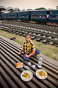 Alamin Hasan, a porter at the Kamalapur Railway Station in Dhaka, Bangladesh, with his day's worth of food.  (From the book What I Eat: Around the World in 80 Diets.) MODEL RELEASED.