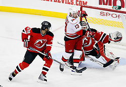 Apr 23, 2009; Newark, NJ, USA; New Jersey Devils goalie Martin Brodeur (30) makes a glove save through a screen by Carolina Hurricanes left wing Ray Whitney (13) during the first period of game five of the eastern conference quarterfinals of the 2009 Stanley Cup playoffs at the Prudential Center.