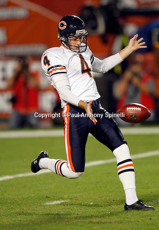 Chicago Bears punter Brad Maynard (4) punts during the NFL week 11 football game against the Miami Dolphins on Thursday, November 18, 2010 in Miami Gardens, Florida. The Bears won the game 16-0. (©Paul Anthony Spinelli)