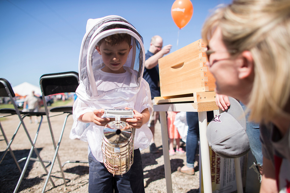 Lane Pozza (5) wears a beekeeper hood and holds a smoker as he explores the booths at the Breakfast on the Farm event near Shedden, Ontario, Saturday, June 24, 2017.<br /> Farmers Forum/ Geoff Robins