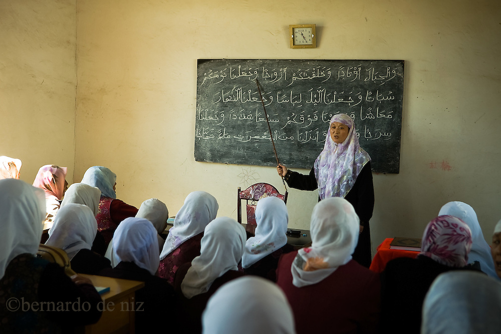 Ma Shao Feng, a female imam, teach in a very small courtyard in the Dujia Tan Mosque in northwest China's Ningxia Hui Autonomous Region, China, on Thursday, September. 11, 2008. The islam is the second biggest religion in China, where there are between 20 and 30 millions of muslims.