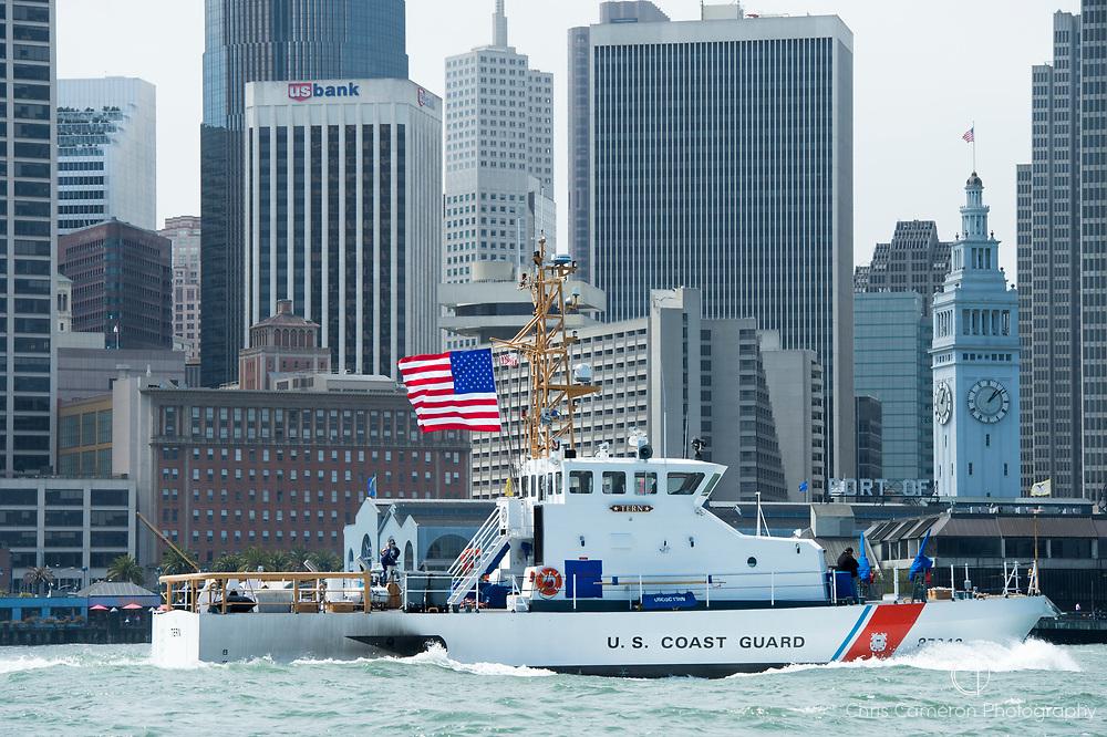 U.S. Coast guard vessel Tern steams past the San Francisco waterfront. California, USA.