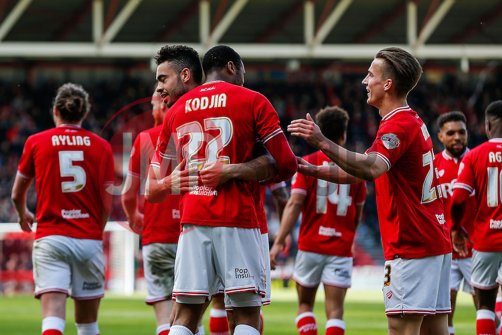 Jonathan Kodjia of Bristol City celebrates with Derrick Williams after scoring a goal to make it 3-0 - Mandatory byline: Rogan Thomson/JMP - 30/04/2016 - FOOTBALL - Ashton Gate Stadium - Bristol, England - Bristol City v Huddersfield Town - Sky Bet Championship.