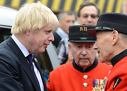 © Licensed to London News Pictures. 02/05/2012. London, UK Boris Johnston listens to a Chelsea Pensioners story. London Mayor, Boris Johnson is joined by comedian Al Murray to wave off an army of WWII veterans who are embarking on an iconic trip to the Netherlands, via a convoy of black cabs. The London Taxi Benevolent Association for the War Disabled has organised a trip for 160 WWII veterans to travel to Holland in 80 London Black Cabs. The veterans, mostly aged between 85 and 94, will start their journey from London today 2nd May 2012 and will be visiting sites of importance from WWII and taking part in Dutch Liberation Day celebrations as guests of honour of the Dutch Royal Family.. Photo credit : Stephen Simpson/LNP