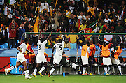 Ghanian players celebrate their team mate Asamoah Gyan's goal during the 2010 FIFA World Cup South Africa Group D match between Serbia and Ghana at Loftus Versfeld Stadium on June 13, 2010 in Pretoria, South Africa.