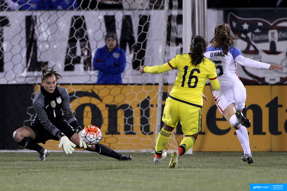Goalkeeper Hope Solo, USA, makes a save from Leicy Santos, Colombia, during the USA Vs Colombia, Women's International friendly football match at the Pratt & Whitney Stadium, East Hartford, Connecticut, USA. 6th April 2016. Photo Tim Clayton