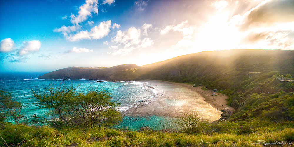Oahu, Hawaii. This bay is legendary. Practically untouched by the raging waters of the Pacific ocean because it is protected by the rocky coast and a reef. There's a delicate and beautiful ecosystem in this place. As you can see, the sun sets over the ridge and creates an amazing light show for the remaining visitors.