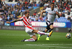 Joselu of Stoke City (L) scores his sides first goal - Mandatory by-line: Jack Phillips/JMP - 29/07/2017 - FOOTBALL - Macron Stadium - Bolton, England - Bolton Wanderers v Stoke City - Pre-Season Club Friendly