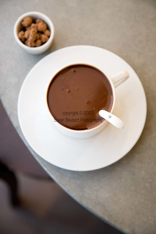 Special Spicy Dark Drinking Chocolate: 72% Arriba Dark Chocolate (Ecuadorian) infused with cayenne pepper, smoked paprika, ginger then blended with milk, cream and coconut milk.  Shown here with cocoa dusted cacao nibs from Coppeneur (Germany)