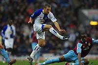 Photo: Paul Greenwood.<br />Blackburn Rovers v West Ham United. The Barclays Premiership. 17/03/2007.<br />Blackburn's David Bentley (L) shoots past Nigel Reo-Coker