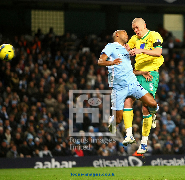 Picture by Paul Chesterton/Focus Images Ltd.  07904 640267.03/12/11.Steve Morison of Norwich scores his sides 1st goal and rushes to retrieve the ball with team mate Andrew Surman during the Barclays Premier League match at the Etihad Stadium, Manchester.