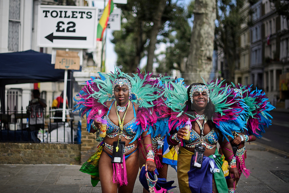 © Licensed to London News Pictures. 29/08/2016. London, UK. A carnival goers in costume make their way to day two of the Notting Hill carnival, the second largest street festival in the world after the Rio Carnival in Brazil, attracting over 1 million people to the streets of West London.  Photo credit: Ben Cawthra/LNP