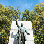 Statue of America's 26th president with blue sky at the Theodore Roosevelt Memorial in Arlington, Virginia.