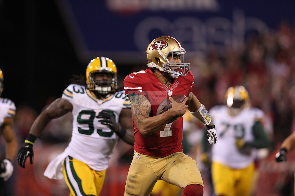 San Francisco 49ers quarterback Colin Kaepernick (7) runs for a touchdown during a NFL Divisional playoff game against the Green Bay Packers at Candlestick Park in San Francisco, Calif., on Jan. 12, 2013. The 49ers defeated the Packers 45-31. (AP Photo/Jed Jacobsohn)