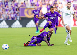 April 8, 2018 - Orlando, FL, U.S. - ORLANDO, FL - APRIL 08: Orlando City defender Mohamed El-Munir (13) jumps over his team mate Orlando City defender Lamine Sane (22)during the MLS socce r match between the Orlando City FC and the Portland Timbers at Orlando City SC on April 8, 2018 at Orlando City Stadium in Orlando, FL. (Photo by Andrew Bershaw/Icon Sportswire) (Credit Image: © Andrew Bershaw/Icon SMI via ZUMA Press)