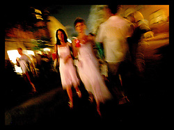 05 August 2006 - New Orleans - Louisiana. White Linen Night. The annual art gallery walk where it is traditional to wear white linen. Women slice through the crowd.