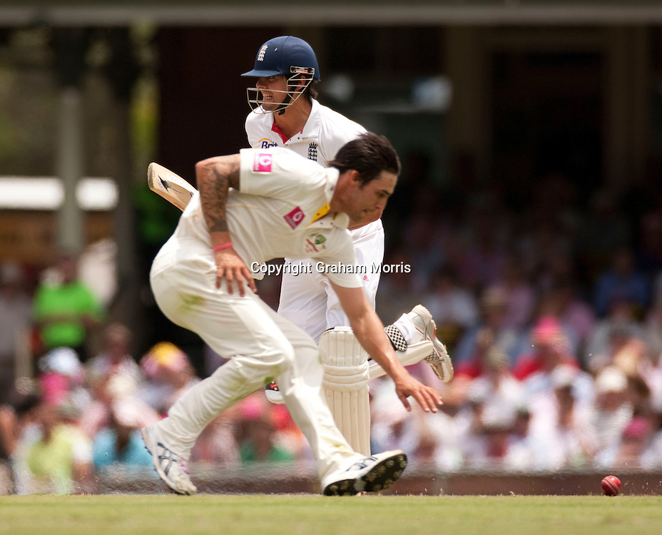 Alastair Cook runs past bowler Mitchell Johnson during his century in the fifth and final Ashes test match between Australia and England at the SCG in Sydney, Australia. Photo: Graham Morris (Tel: +44(0)20 8969 4192 Email: sales@cricketpix.com) 05/01/11