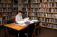 young woman studying in university library.