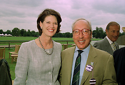 MR & MRS URS SCHWARZENBACH he is the millionaire Swiss polo patron, at a polo match in Cirencester on 24th June 1997.LZP 22
