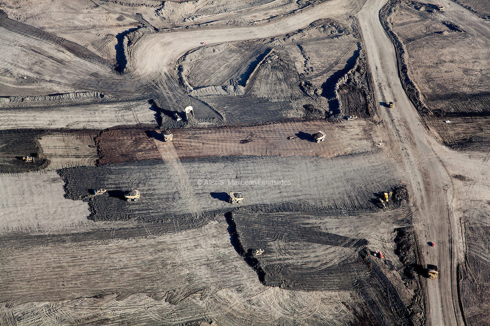 Large haul trucks perform mining operations at Syncrude Mildred Lake mine